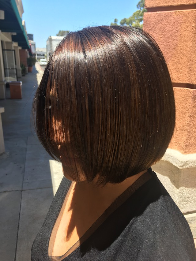 A bob hair cut with High lines with low lites